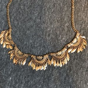 Statement necklace gold with silver.
